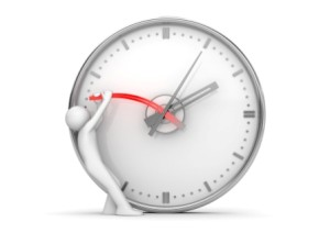 bigstock-Stopping-Clock-Hands-To-Stop-T-6969159
