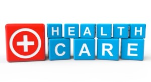 Cubes with Health Care sign on a white background